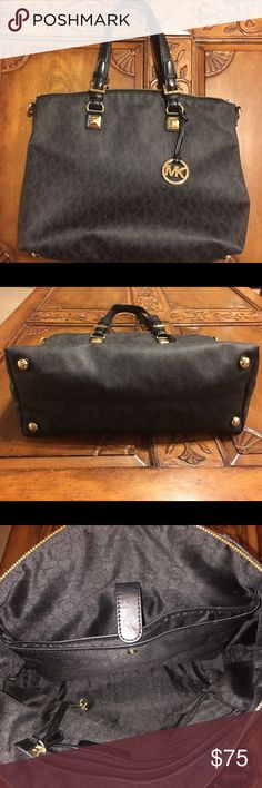 Authentic Michael Kors Tote Coated canvas with leather trim. Multiple interior pockets including small laptop or iPad pocket. Feet on the bottom and bold hardware. In excellent condition Michael Kors Bags Totes