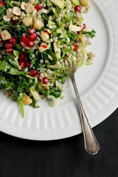 Winter slaw with buckwheat, toasted hazelnuts, pomegranate seeds and a tamari almond butter dressing. Vegan and gluten free.
