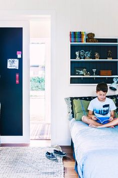 In this kids' bedroom, the back of the sliding door is finished with magnetic paint, Resene Magnetic Magic, to create space for the display of awards and mementos.