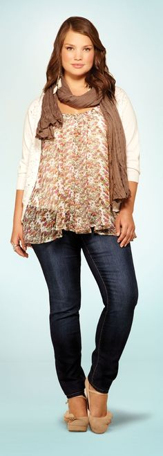 A great example of layers that work well. She is standing in an unflattering pose and still looks good. plus size outfit