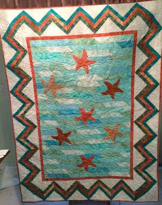 Handmade appliqued starfish throw or lap quilt. Coral Fabric, String Quilts, Light Turquoise, Blue Bags, Machine Quilting, Starfish, Hand Stitching, Applique, Pattern