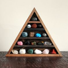 crystal and mineral stone collection in handmade triangle wood curio shelf