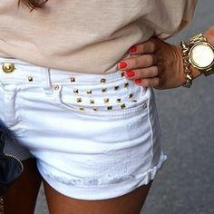 gold studded white shorts