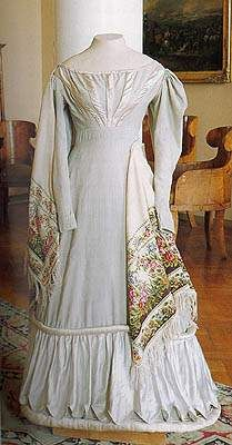 Circa 1820 Dress, St. Petersburg, Russia, made of cashmere and satin.  The kolokoltsevskaya shawl (made at the A. D. Kolokoltsev workshop) circa 1830-1840s is made of thin wool, embroidered with woolen thread.