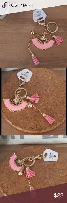 "NWT Gorgeous Enamel Fan Tassel Purse Charm - Pink PINK. This is such an adorable purse charm! Solid gold-tone hardware with pink enamel and sparkly pink crystals. It is a high-quality piece that will be so much fun to carry!  No one will guess what a great price you paid for it! Also available in blue - see my other listing! Approx. 7"" long x 2.75"" wide Accessories Key & Card Holders"