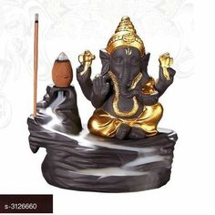Religious Idols & Paintings Budha Ceramic Smokey Fog Fountain Gift Material: Ceramic Size: L x W - 5 in x 3 in Description: It Has 1 Piece Of Ganesh Statue (5 Cones Free) Country of Origin: India Sizes Available: Free Size   Catalog Rating: ★3.9 (1472)  Catalog Name: Elite Budha Ceramic Smokey Fog Fountain Gifts Vol 8 CatalogID_428950 C128-SC1316 Code: 071-3126660-792