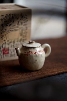 A fully handmade teapot, hand written with Chinese red characters, also copper on the top of rims, both lids and teapot.