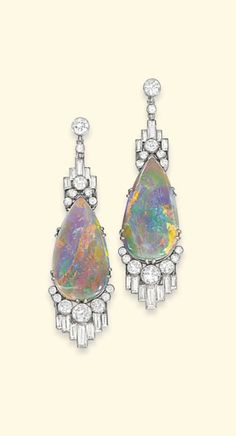 A PAIR OF ART DECO OPAL AND DIAMOND EAR PENDANTS -  Each designed as a drop-shaped opal, the terminals decorated with staggered baguette-cut and circular-cut diamonds collets to the diamond surmount, circa 1930