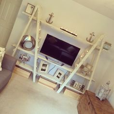 I made this to uni by using to old wooden ladders and scaffolding planks :) Sanded them all down shabby chic them and this was the end result :)