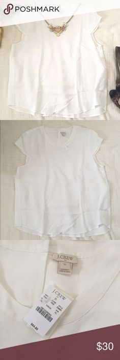 🆕 J. Crew Ivory Cap-Sleeve Crepe Blouse Cap-sleeve sleeve ivory blouse. Material is heavier than cotton (see tag). There's a little texture in the blouse as well. Described as crepe when I bought it.  The back drapes lower than the front and the hem is curved. J. Crew Tops Blouses