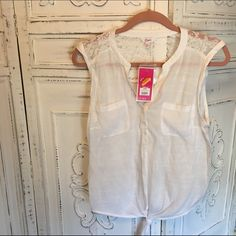 NWT White Sleeveless Front Tie Top White sleeveless top with front tie and lace details over the shoulders. Candie's Tops Tank Tops