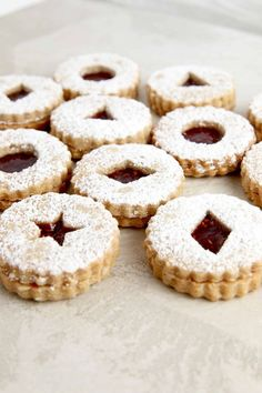 Linzer cookies are really special not just because theyre uniquely delicious but because theyre so beautiful! I make Linzers for all kinds of occasions from Valentines Day to Christmas! When I make them for holidays outside of Christmas I usually l Baking Recipes, Cookie Recipes, Dessert Recipes, Christmas Desserts, Christmas Cookies, Christmas Bells, Holiday Baking, Christmas Baking, Middle Eastern Desserts