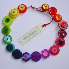 Gorgeous button necklace, with all the colours of the rainbow! The buttons are threaded onto cotton coated wire, which holds its shape beautifully around the neck, and fastens with a silver plated lobster clasp. The necklace measures in length, . Button Art, Button Crafts, Button Moon, Crafts To Make, Crafts For Kids, Arts And Crafts, Easy Crafts, Jewelry Crafts, Handmade Jewelry