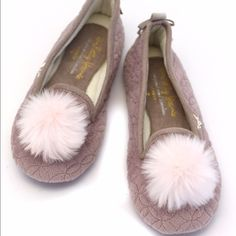 Poof top Ballerina Slippers Slip on ballerina style slippers with faux fur poof detail on the toe. Small bow with Crystal button on the back.  Pretty maybe color with soft pink poof.  Very cushioned bottoms and rubber soles that allow for indoor/outdoor use. These also make GREAT gifts. Easy, comfy, cute. Shoes Slippers