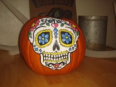 """I hand-painted this Dia De Los Muertos Sugar Skull Pumpkin using Apple Barrel Paints and a little """"Pinsperation"""". I recommend finding a pumpkin that has flatter sides and more shallow grooves than this one! Pumpkin Uses, A Pumpkin, Pumpkin Carving, Halloween Town, Halloween Pumpkins, Halloween Decorations, Sugar Skull Pumpkin, Sugar Skulls, Apple Barrel"""