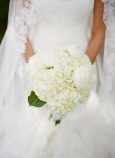 Vera Wang June gown. Bride's wedding bouquet. Hydrangea peony wedding bouquet.