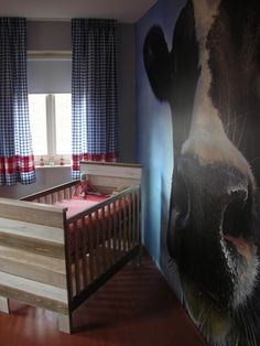 The crib is lovely. The giant cow invading the child's living space and nightmares...WTF???