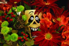 Tuck a dollar store cup inside your flower arrangement to add to the fun!!! http://www.fearlessentertaining.com/