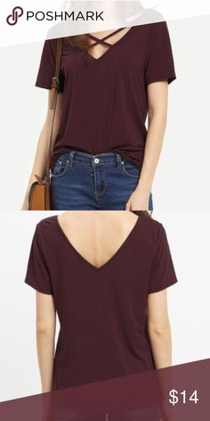 """Burgundy Criss Cross Front Tee Casual, burgundy short sleeve top with cross cross front. Great color!  Sizes available: Small Measurements: M: 23"""" length and  17"""" chest  *NO TRADES*  ⭐️Use the """"Buy Now"""" or """"Add to Bundle"""" button to select your size for Purchasing. 10% off bundling available. ⭐️ Boutique Tops Tees - Short Sleeve"""
