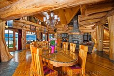 Greatroom in what I assume is round log post-and-beam home by Pioneer Log Homes of British Columbia