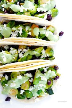 Brussels Sprouts Tacos -- quick and easy to make, and made with a heavenly creamy avocado sauce!   gimmesomeoven.com