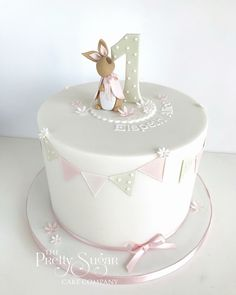 Browse through the different cakes we create here at The Pretty Sugar Cake Company, from Wedding Cakes & Wedding Favours to Celebration Cakes, to Cupcakes & Cookies. 1 Year Old Birthday Cake, 1 Year Old Cake, 1st Year Cake, 1st Birthday Cake For Girls, Baby Birthday Cakes, Birthday Wishes, Beatrix Potter Cake, Luxury Cake, Rabbit Cake