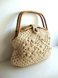 This looks a little bit like the macramé bag I made as a teen, except the handles are different....b