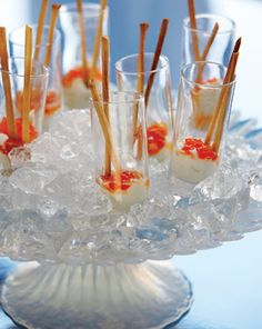 These caviar shooters are unexpected treats and a fun way to surprise your guests—put together just before serving on a bed of crushed ice. How to assemble: Place a tablespoon of garlic-infused yogurt in a tall shot glass. Top with a teaspoon of salmon roe caviar. Serve with breadsticks that can be used as spoons - Ideas for Every Season