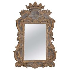18th Century Italian Mirror with Crown | From Skelton - St. John Antiques and available at http://www.1stdibs.com/dealers/skelton-st-john/