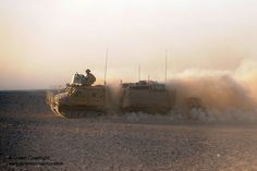A Viking armoured vehicle crosses the Afghan desert transporting troops to an operation in Helmand, Afghanistan.