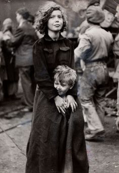 Jewish girl and her brother, refugees from Poland, fearfully await deportation after being denied entry into Palestine by British authorities.