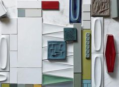 A mix of current production field tiles and colors sit side-by-side with some of Heath's current production oval tiles. The turquoise tile (center) is an experimental design from 1960.