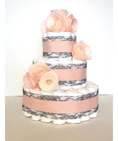 """""""Now taking diaper cake orders call for availability! #Pinterest #inspiration #orders #design #decor #boutique #diapers #baby #boy #girl #gift 818-249-7980"""""""
