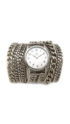Sara Designs All Chain Wrap Watch    An assortment of glittering chains wrap the wrist for a glamorous, layered look on this oversized, silver-plated watch. Adjustable length and lobster-claw clasp.    Water resistant to 10 meters.  Made in the USA.    MEASUREMENTS  Dial: 1.25in / 3cm  Length: 21-22in / 53-56cm