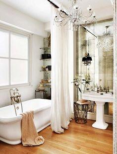 Glamorous Bathroom - mirrors transform this room