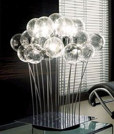 Completing Your Home Interior with Beautiful Floral Lamps Furniture with many bubble glass lamps style with steel legs
