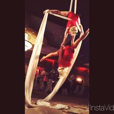 Two of our aerialists in a hand-to-hand exhibition at a Gatsby event! aerial duo, aerial silks partnering, J&D Entertainment Houston, TX www.jdentertain.com