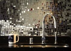 Mirror mosaic backsplash. So beautiful!