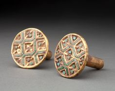 Gold and turquoise ear ornaments with a net design, pre-Columbian,  1 AD-800 AD