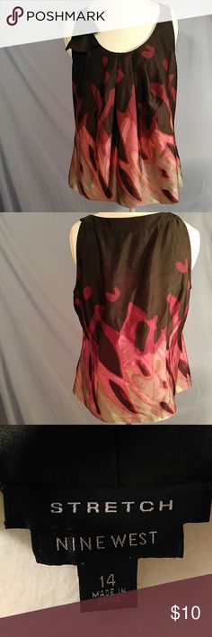 NWOT Nine West sleeveless blouse, Size 14 Never worn Nine West sleeveless blouse with pleading around the neck and ruffle detail on the right shoulder. Nine West Tops Blouses
