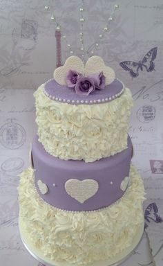 Swirls & pearls 3 tier wedding cake with lace hearts, roses & topper
