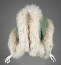 """Marilyn's Russian Lynx fur stole with a sage green wool lining.  ~ """"The Personal Property of Marilyn Monroe,"""" Christie's, New York"""