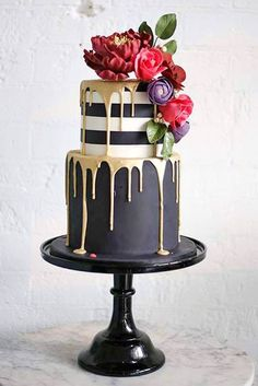 36 Drip Wedding Cakes Almost Too Pretty To Eat. Gold, black and white drip cake. #dripcake See more at http://www.theweddingguru.ca/36-drip-wedding-cakes-almost-too-pretty-to-eat/