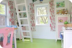 The inside of a precious little playhouse. This is just what I envision for my little girl. :)
