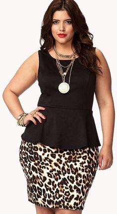 Denise Bidot in Leopard Print Peplum Dress