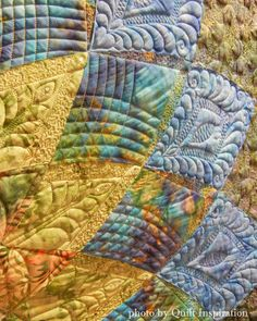 Midnight Dahlia by Elaine Putnam, quilted by Gina Perkes.  Exemplary Machine Quilting, 2015 AZQG.  closeup photo by Quilt Inspiration