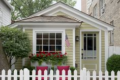 It's hard to believe this cute-as-a-button 780-square-foot historic cottage sits in the middle of a bustling metropolis. The house, owned by David Hawkanson, the executive director of Chicago's Steppenwolf Theater Company, was built a few years after the Great Chicago Fire of 1871, when the Chicago Relief and Aid Society began offering so-called fire-relief cottage kits that included pre-cut wood, a door, a  Read more about this tiny Chicago dwelling.   - HouseBeautiful.com
