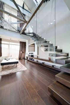 Literally cannot describe my love for this. I love the open space and the contrast of the dark browns and the white walls plus the glass wall for the stairs.