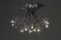 Roots ,Handmade ceiling light made of pewter wires On Sales! Original price 1,600.00 Euros. Now price at Etsy 990.00.