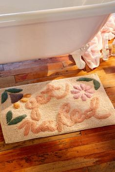 Check out Get Naked Floral Bath Mat from Urban Outfitters